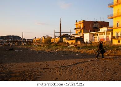 NAPOLI, ITALY - MARCH 24, 2021 - Bagnoli, Coroglio beach, in the western part of Napoli, ex area of the Italsider factories. Environmental degradation