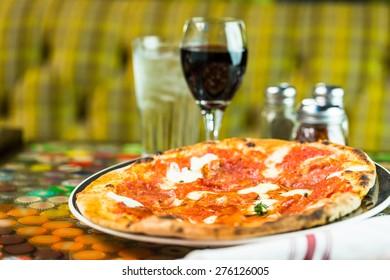Napolitana Style Pizza on the table in Italian restaurant.