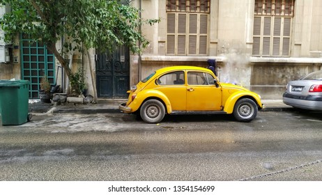 Naqoura Lebanon on March 30, 2018: a yellow car was in the Parkind od side of the alley