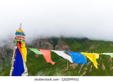 Nar village, Annapurna Conservation Area, Nepal - July 21, 2018 : Traditional buddhist prayer flags over foggy mountain background, are used to bless the surrounding countryside and to promote peace