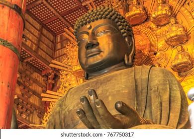 Nara, Japan - April 26, 2017: Details of Great Buddha or Daibutsu, the world's largest bronze statue of Buddha Vairocana. Todai-ji a Buddhist Temple in Nara, Japan.