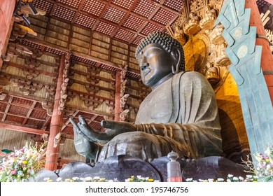 NARA, JAPAN - APRIL 6: The Great Buddha in Todai-ji temple on April 6, 14 in Nara. It is a Buddhist temple complex which houses the world's largest bronze statue of the Buddha Vairocana (Daibutsu).