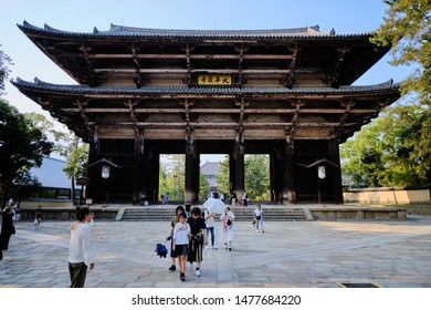 Nara / Japan - August 3rd 2019: The large wooden south gate, the Nandaimon gate, at the entrance to Todaiji temple housing to guardians, the Nio kings.
