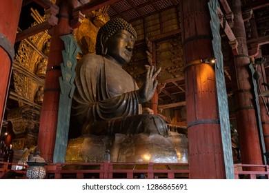 NARA, JAPAN - DEC 7 2018: Details of Great Buddha or Daibutsu, the world's largest bronze statue of Buddha At Todai-ji a Buddhist Temple in Nara, Japan.