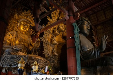NARA, JAPAN - DEC 7 2018: The Daibutsuden at Nara has the world's largest bronze statue of the Buddha and other two Bodhisattava (seen left).