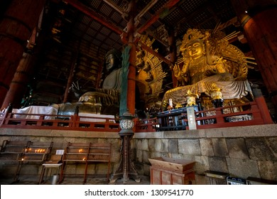 NARA, JAPAN - DEC 7 2018: The Daibutsuden at Nara has the world's largest bronze statue of the Buddha and other two Bodhisattava.