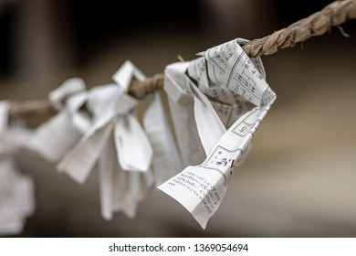 Nara / Japan - December 10th 2017: Omikuji, random fortunes written on strips of paper at Shinto shrines and Buddhist temples in Japan