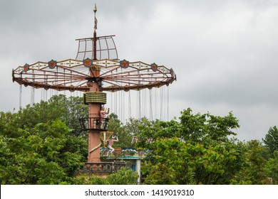 Nara, Japan - June 10 2016: Swing ride (or chair swing ride) in the abandoned Nara Dreamland theme park, which was heavily inspired by Disneyland. It is now demolished.