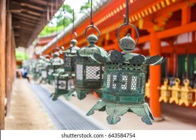 Nara, Japan at Kasuga Taisha Shrine hanging lanterns.