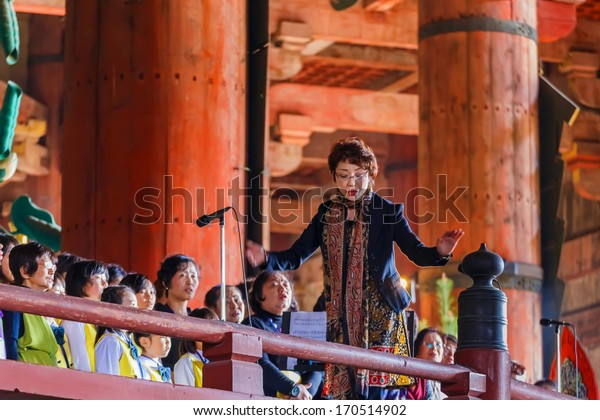 NARA, JAPAN - NOVEMBER 16: Daibutsu Praising in Nara, Japan on November 16, 2013. Unidentified local choir group sing praise at the Daibutsu-den to the Great Buddha at Todaiji Temple