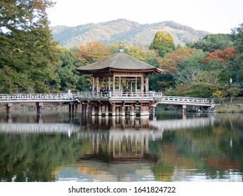 Nara, Japan - November 2, 2019: Ukimido floating pavilion reflecting in the lake in Nara deer park in autumn