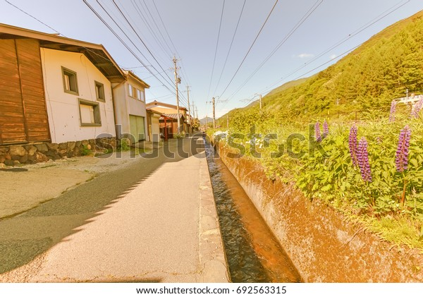 Narai  is a  small town in Nagano Prefecture Japan ,The old  town provided a pleasant walk through about a kilometre of well preserved buildings , soft focus.
