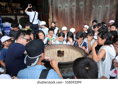 Nara,Japan-June 26,Teacher lead students to be becky incense smoke toward themselves, toward yourself is to bring luck,at Todiji temple on June 26,2016 in Nara,Japan