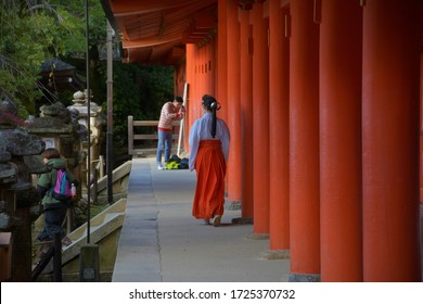 NARA,KANSAI,JAPAN. NOVEMBER 2019 Woman walking through a temple.