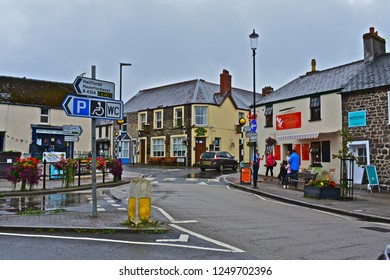 Narberth, Pembrokeshire / Wales UK - 8/3/2018 : Crossroads at the top of the busy High Street in the upmarket rural town of Narberth on a wet day in the middle of summer!