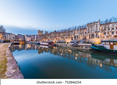 NARBONNE, FRANCE - FEBRUARY 13, 2016: Canal de la Robine passing through the city of Narbonne in Languedoc-Roussillon-Midi-Pyrenees, France