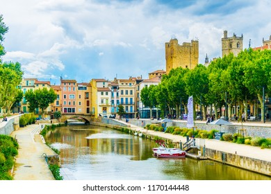 NARBONNE, FRANCE, JUNE 27, 2017: Canal de la robine flowing through the city center of Narbonne, France