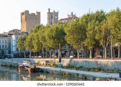 Narbonne is a town in southern France on the Canal de la Robine. The Gothic Cathédrale Saint-Just et Saint-Pasteur was begun in the 13th century but never completed