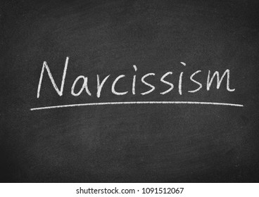 narcissism concept word on a blackboard background