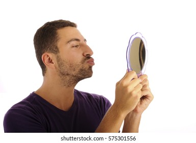 Narcissist, young man holding a mirror