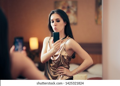 Narcissistic Woman Taking a Selfie in the Mirror. Funny party girl taking pictures for social media with her Smartphone