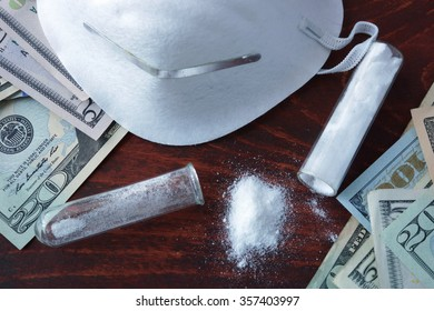 Narcotics making and trafficking concept. Cash and white powder with mask.