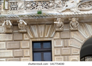 NARDO, ITALY - APR 7, 2019 - Whimsical sculpted figures on struts of a  balcony in Nardo, Puglia, Italy