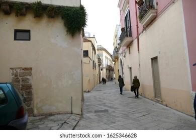 NARDO, ITALY - APR 7, 2019 - Cast iron grills and lanterns on narrow street of Nardo, Puglia, Italy
