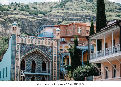 Narikala, Jumah Mosque, famous colorful balconies in old historic district Abanotubani. Exterior of public Sulphur bath in Tbilisi Georgia a fine example of islamic architectural style.