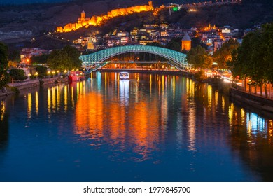 Narikala or Old Fortress of Tbilisi and the Bridge of Peace at Kura river in Tbilisi city in Georgia in Caucasus region in Eastern Europe and Western Asia - Shutterstock ID 1979845700