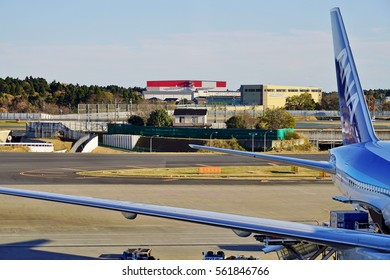 NARITA, JAPAN -6 DEC 2016- A farm house surrounded by a fence in the middle of Tokyo Narita Airport (NRT). Farmers have protested the construction of the airport since the 1960s and refused to move.