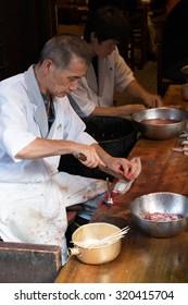 Narita, Japan, 9 September 2015, Man Preparing Eels for Japanese Grill
