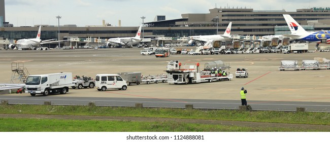 NARITA, JAPAN - MAY 2018 : Ground support equipment stand by for services in Apron near aircraft bay.