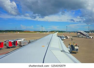 Narita / Japan - september 09 2018: Flight arrival Narita International airport (NRT). Unloading baggage. Unloading Luggage On Runway