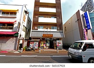 NARITA-JAPAN-OCTOBER 22 : Shoppers pass through Sando traditional street October 21, 2015 in Narita, JP. The historic town is a popular destination located near Narita International Airport.