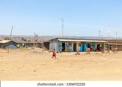 Narok, Kenyan, 2015, February. Stores in a shed in the Kenyan countryside with people