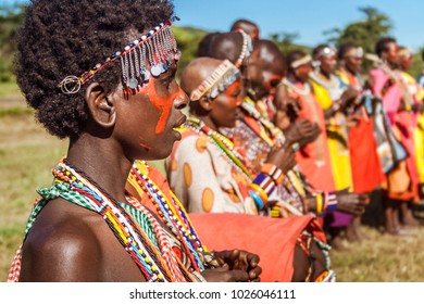 Narok, Masai Mara, Kenya, May 23, 2017: Masai women in traditional costume lined up during a ceremony