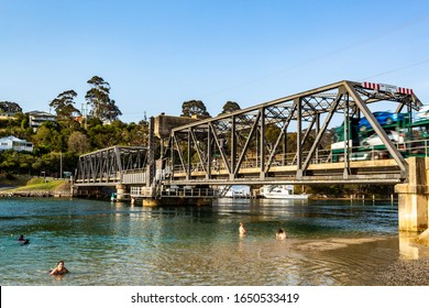 NAROOMA, AUSTRALIA – December 19, 2019: View from the south east of the road bridge over the Wagonga Inlet, completed in 1931 in Narooma, South Coast of New South Wales, Australia