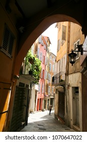 naroow back streets and colorful houses of the medieval city of grasse in the south of france