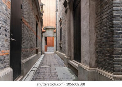 Narrow alley with antique brick walls, Xintiandi and Shanghai Shikumen building style in the French Concession area of Shanghai, China