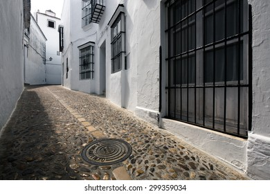 Narrow alley in Arcos de la Frontera, one of the white towns in Andalusia, Spain