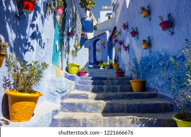 Narrow alley in blue streets of Chefchaouen, Morocco.