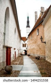 The Narrow Alley of Borsi Kaik in the Beautiful Old City of Tallinn, Estonia withe Tower of the Holy Spirit Church