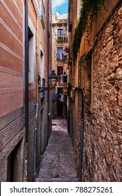 Narrow alley and houses in Old Jewish Quarter - The Call in Girona city, Catalonia, Spain