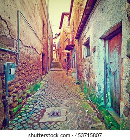 Narrow Alley with Old Buildings in Italian City of Cave, Retro Effect