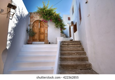Narrow alley and traditional Greek architecture of Lindos, Rhodes Island, Greece