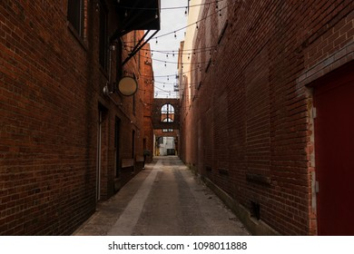 Narrow Alleyway with Brick Buildings