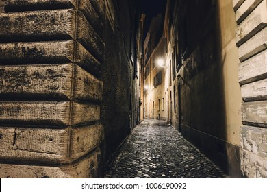 Narrow alleyway in Rome at night. Mystery atmosphere