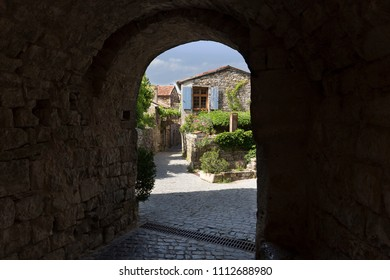 Narrow alleyway in the village of Naves, France