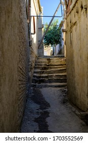 Narrow ancient pedestrian street with stairways in old town. Central Asia travel view